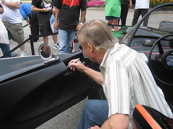 Adam West Signs The Rock Star Batmobile